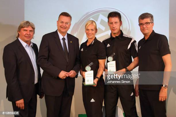 Referees Bibiana Steinhaus and Wolfgang Stark are awarded as referees of the year 2017 by Ronny Zimmermann Reinhard Grindel head of the DFB and...