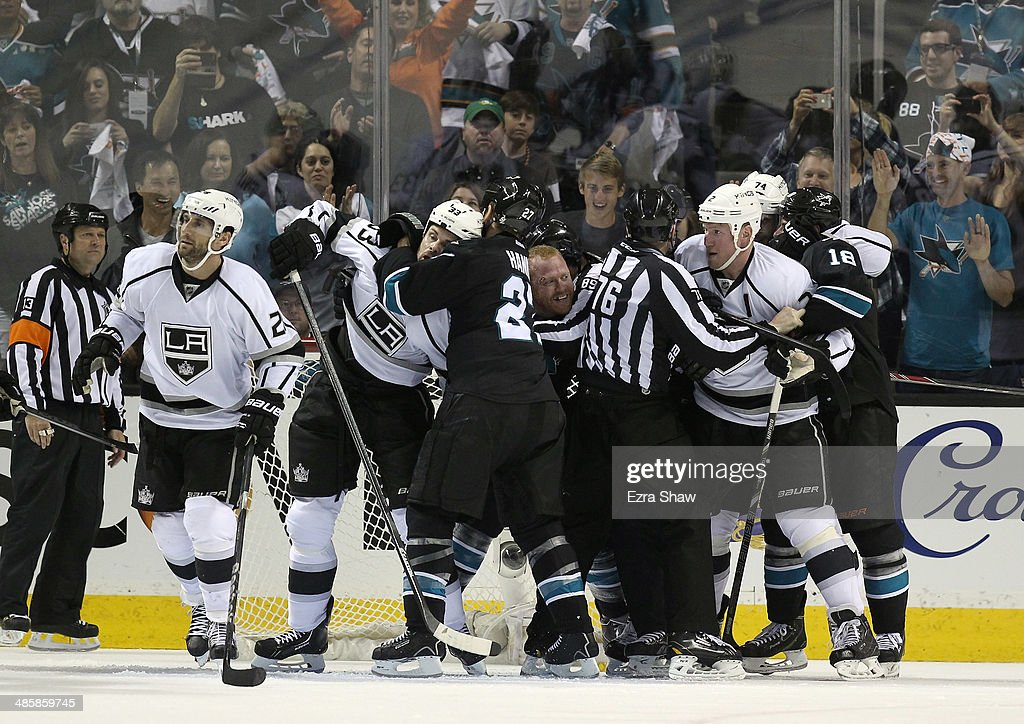 Referees break up a fight between the Los Angeles Kings and the San Jose Sharks in Game Two of the First Round of the 2014 NHL Stanley Cup Playoffs at SAP Center on April 20, 2014 in San Jose, California.