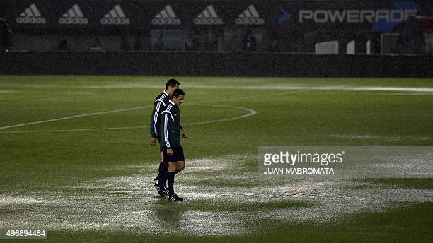 FIFA referees check the field before the Russia 2018 FIFA World Cup South American Qualifiers football match Argentina vs Brazil in Buenos Aires on...