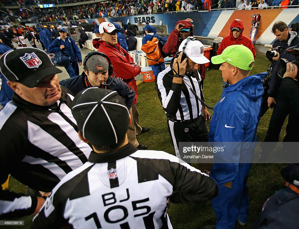 Referees confer on a suspension of the game between the Chicago Bears and the Baltimore Ravens due to weather at Soldier Field on November 17, 2013 in Chicago, Illinois. A fast-moving storm system that produced at least one tornado in Illinois has suspended the game and forced fans to evacuate.