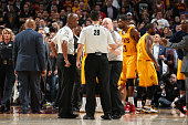 NBA referees Derrick Stafford Joe Crawford and Zach Zarba discuss a play during the game between the Cleveland Cavaliers and Chicago Bulls in Game...