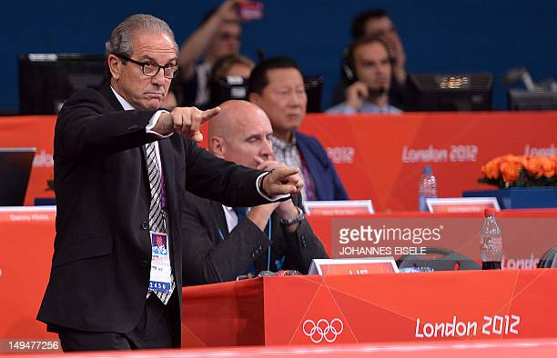 Referees director Juan Carlos Barcos speaks to the referee and judges of the men's 66kg quarter final match between Japan's Masashi Ebinuma and...