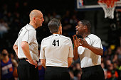 Referees Eric Dalen Ken Mauer and Leroy Richardson talk as they oversee the action between the Phoenix Suns and the Denver Nuggets at Pepsi Center on...