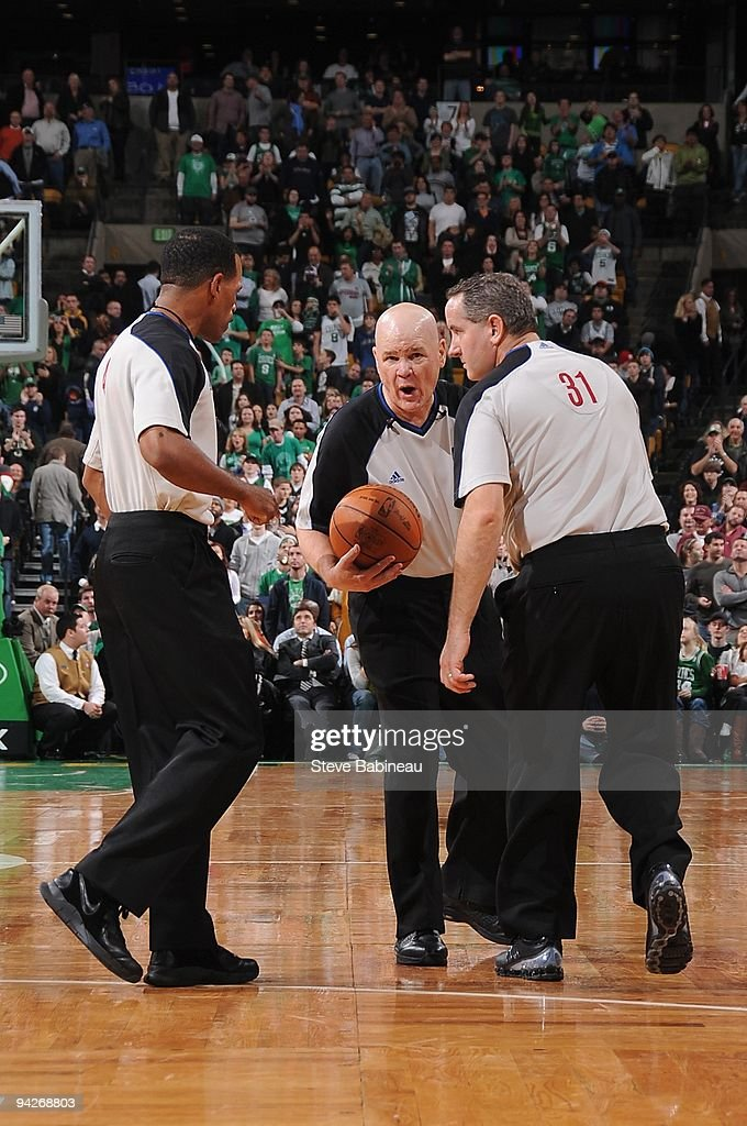 Referees Eric Lewis Joe Crawford and Scott Wall huddle during the game between the Boston Celtics and the Philadelphia 76ers on November 25 2009 at...