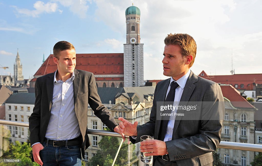 Referees <a gi-track='captionPersonalityLinkClicked' href=/galleries/search?phrase=Felix+Brych&family=editorial&specificpeople=707645 ng-click='$event.stopPropagation()'>Felix Brych</a> (R) and Michael Bacher talk to each other during the Referee Of The Year 2013 awarding ceremony at Hotel Bayerischer Hof on August 29, 2013 in Munich, Germany.