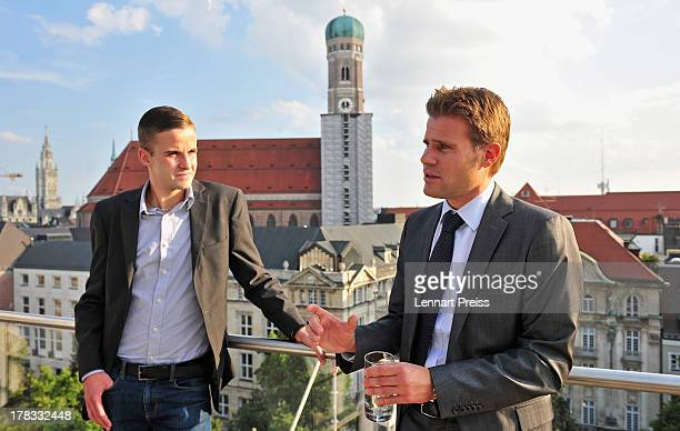 Referees Felix Brych and Michael Bacher talk to each other during the Referee Of The Year 2013 awarding ceremony at Hotel Bayerischer Hof on August...