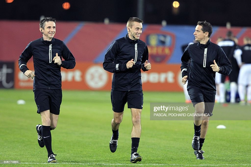 Referees Frederic Cano, Clement Turpin and Nicolas Dano warm up prior to the L1 football match between Gazelec Ajaccio (GFCA) and Guingamp (EAG) on February 6, 2016, at the Ange Casanova stadium in Ajaccio, French Mediterranean island of Corsica. AFP PHOTO / PASCAL POCHARD CASABIANCA / AFP / PASCAL POCHARD CASABIANCA