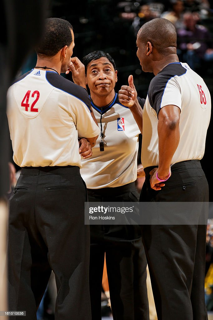 Referees, from left, Eric Lewis #42, <a gi-track='captionPersonalityLinkClicked' href=/galleries/search?phrase=Violet+Palmer&family=editorial&specificpeople=570328 ng-click='$event.stopPropagation()'>Violet Palmer</a> #12 and Sean Wright #65 speak during a game between the Brooklyn Nets and Indiana Pacers on February 11, 2013 at Bankers Life Fieldhouse in Indianapolis, Indiana.