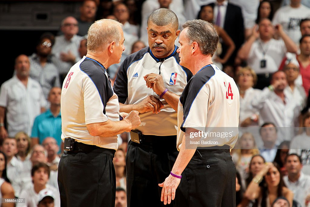 Referees, from right, Mike Callahan #24, Tony Brothers #25 and Bennett Salvatore #15 confer on a call as the Chicago Bulls play the Miami Heat in Game Five of the Eastern Conference Semifinals during the 2013 NBA Playoffs on May 15, 2013 at American Airlines Arena in Miami, Florida.