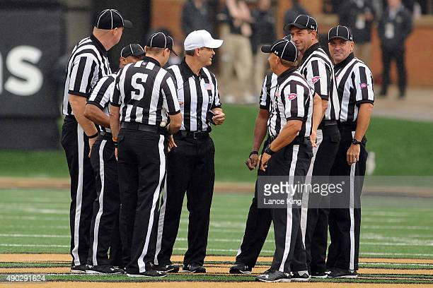 Referees huddle during a game between the Indiana Hoosiers and the Wake Forest Demon Deacons at BBT Field on September 26 2015 in WinstonSalem North...