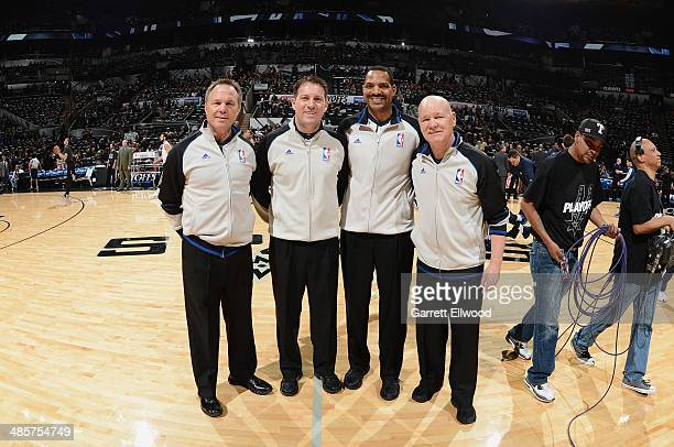Referees Joe Crawford Bennie Adams and Bill Spooner stand on the court in Game One of the Western Conference Quarterfinals during the 2014 NBA...