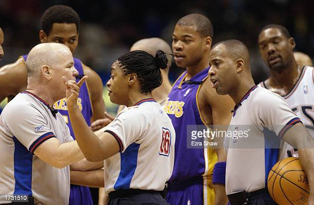 Referees Joe Crawford Violet Palmer and Derrick Stafford discuss a call during the NBA game between the Los Angeles Lakers the New Jersey Nets at...