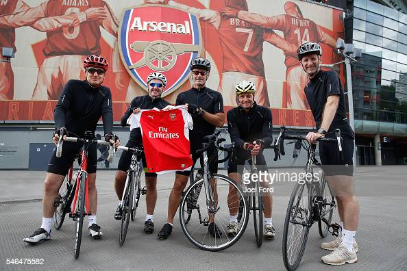 Referees Jon Moss and Martin Atkinson and Mike Riley with support riders Andy Alderson and Jim Butters at the Emirates Stadium during the Premier...