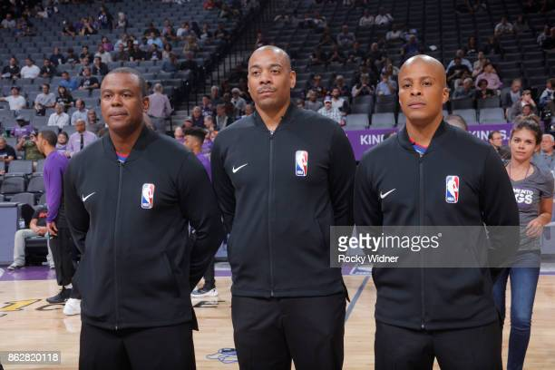 Referees line up for the National anthem of the game between the San Antonio Spurs and Sacramento Kings at Golden 1 Center on October 2 2017 in...