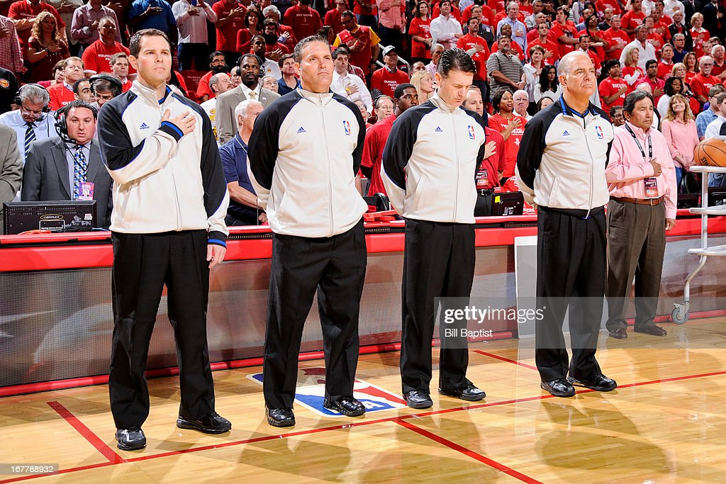 Referees listen to the National Anthem before officiating a game between the Oklahoma City Thunder and Houston Rockets in Game Four of the Western Conference Quarterfinals during the 2013 NBA Playoffs on April 29, 2013 at the Toyota Center in Houston, Texas.