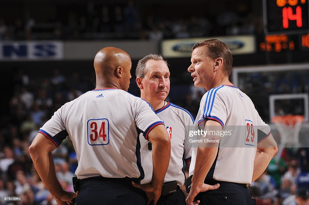 Referees Marc Davis #34, Joe DeRosa #14 and Steve Javie #29 huddle on the court in Game Four of the Western Conference Semifinals between the Dallas Mavericks and the Denver Nuggets during the 2009 NBA Playoffs at the American Airlines Center on May 11, 2009 in Dallas, Texas. The Mavericks won 119-117.