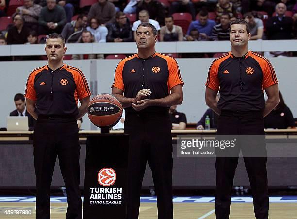 Referees Marcin Kowalski Dani Hierrezuelo and Arnis Ozols are seen before the 20142015 Turkish Airlines Euroleague Basketball Regular Season Date 6...