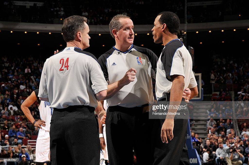 Referees Mike Callahan Scott Wall and Eric Lewis huddle during the game between the Orlando Magic and the Miami Heat on February 28 2010 at Amway...
