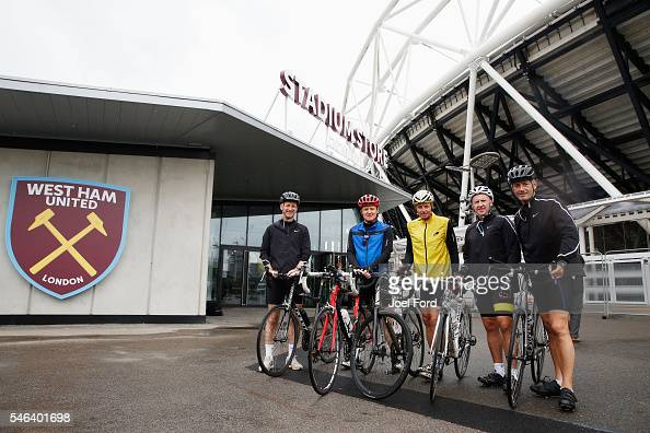 Referees Mike Riley Jon Moss and Martin Atkinson with support riders Andy Alderson and Jim Butters at the Olympic Stadium during the Premier League...