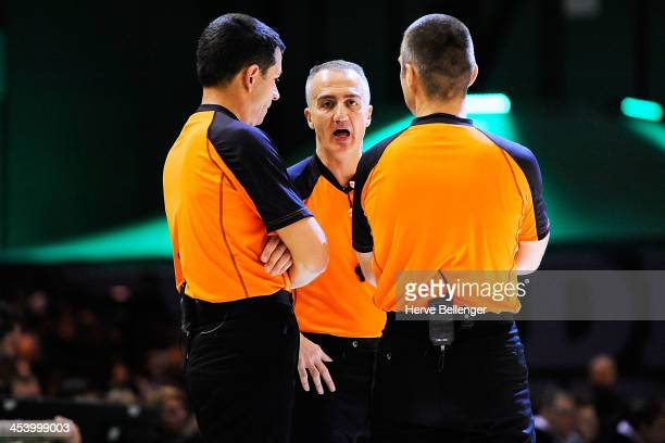 Referees Milivoje Jovcic Carmelo Paternico Robert Lottermoser in action during the 20132014 Turkish Airlines Euroleague Regular Season Date 8 game...