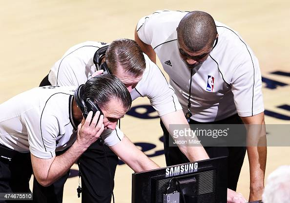 Referees review a play prior to ejecting Al Horford of the Atlanta Hawks from the game for a flagrant foul in the second quarter against the...
