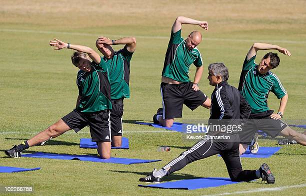 Referees Roberto Rosetti of Italy Howard Webb of England Martin Hansson of Sweden and assistant referee to Rosetti Paolo Calcagno of Italy stretch...