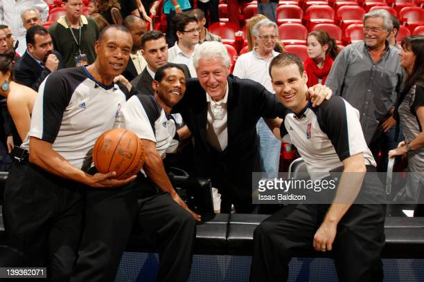 Referees Rodney Mott Bill Kennedy Former US President Bill Clinton and Mark Lindsay pose for a photo after the game between the Orlando Magic and...