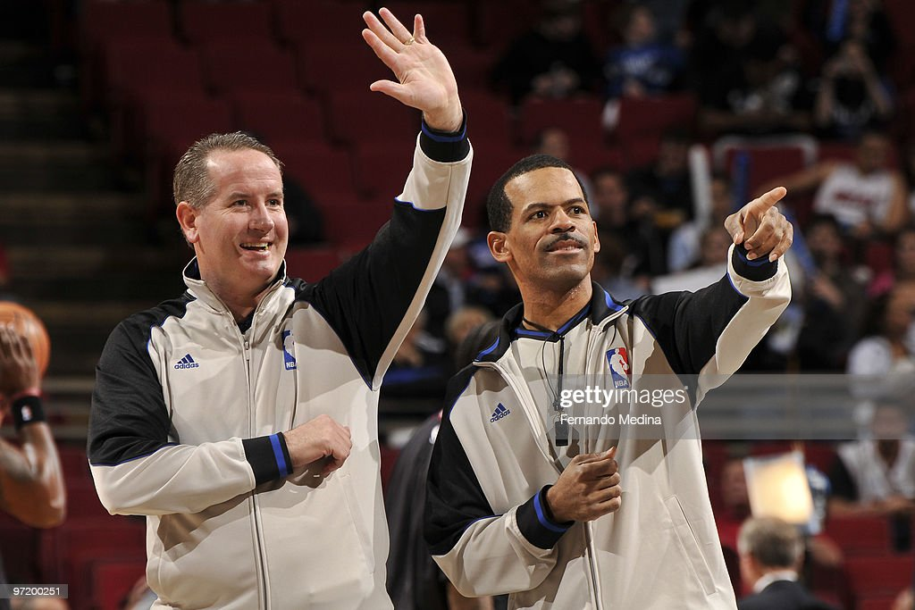Referees Scott Wall and Eric Lewis react before the game between the Miami Heat and the Orlando Magic on February 28 2010 at Amway Arena in Orlando...