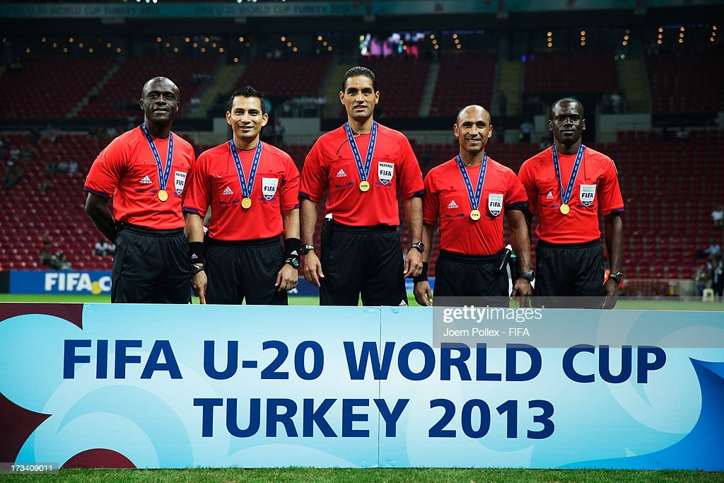 Referees, Songuifolo Yeo, Jose Luis Camargo, Roberto Garcia, Alberto Morin and Noumandiez Doue with their medals after the FIFA U-20 World Cup Final match between France and Uruguay at Ali Sami Yen Arena on July 13, 2013 in Istanbul, Turkey.