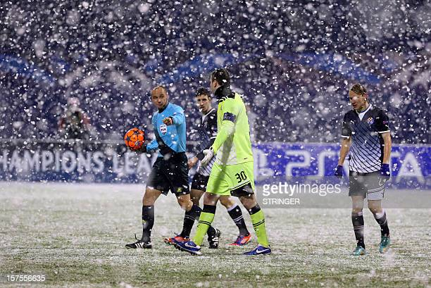 Referees stop the match for 10 minutes because the snow covering the lines during the UEFA Champions League group A football match opposing GNK...