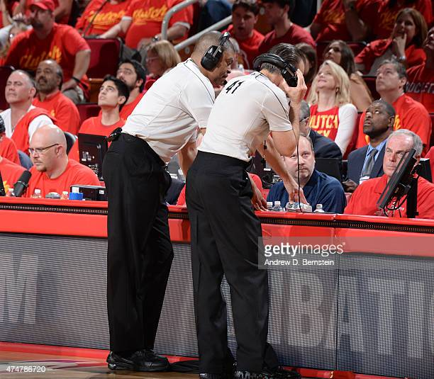 Referees Tony Brothers and Ken Mauer looks at a replay in Game Seven of the Western Conference Semifinals during the 2015 NBA Playoffs on May 17 2015...