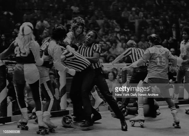 Referees try to keep girls roller derby teams from fighting 31st October 1971