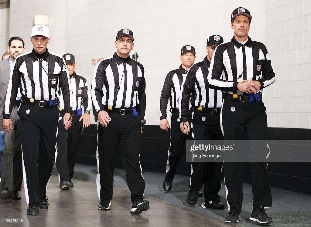 NFL referees walk in the stadium prior to the AFC Championship game between the Denver Broncos and the New England Patriots at Sports Authority Field...