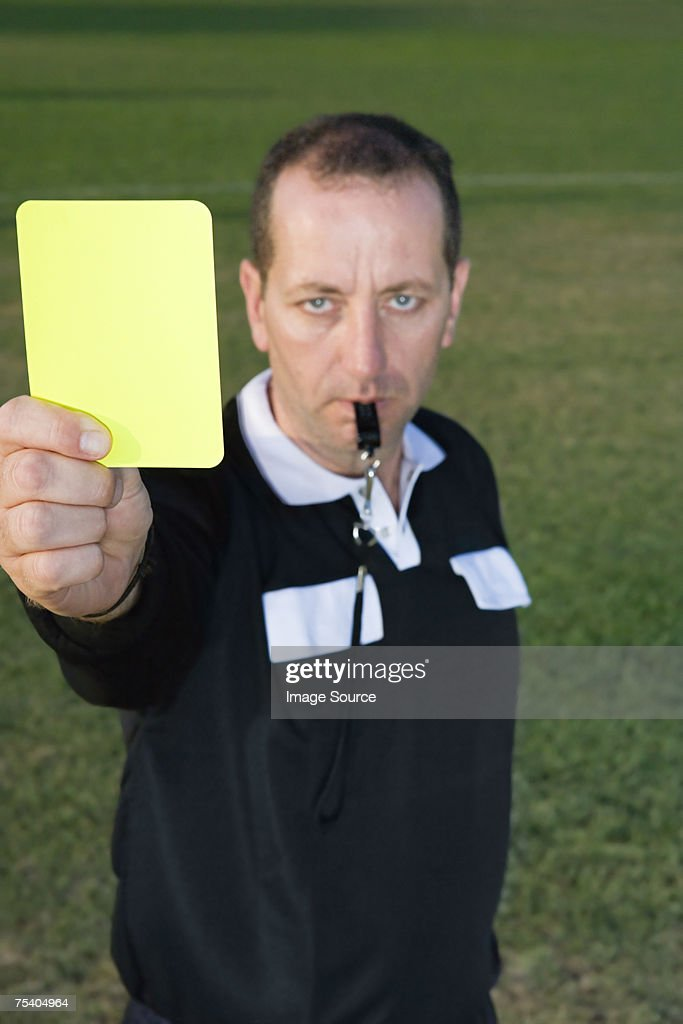 Referre holding yellow card : Stock Photo