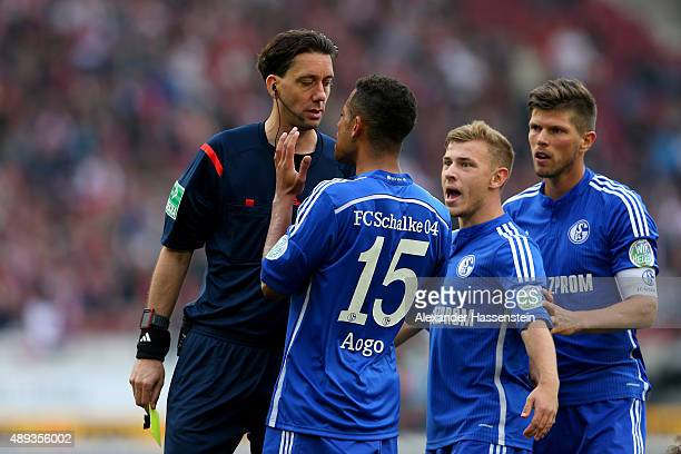 Referre Manuel Graefe reacts to Dennis Aogo of Schalke during the Bundesliga match between VfB Stuttgart and FC Schalke 04 at MercedesBenz Arena on...