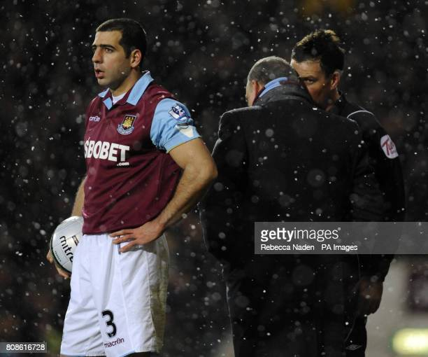 Referre Mark Clattenburg explains to West Ham manager Avram Grant why he disallowed their goal ball during the Carling Cup Quarter Final match at the...