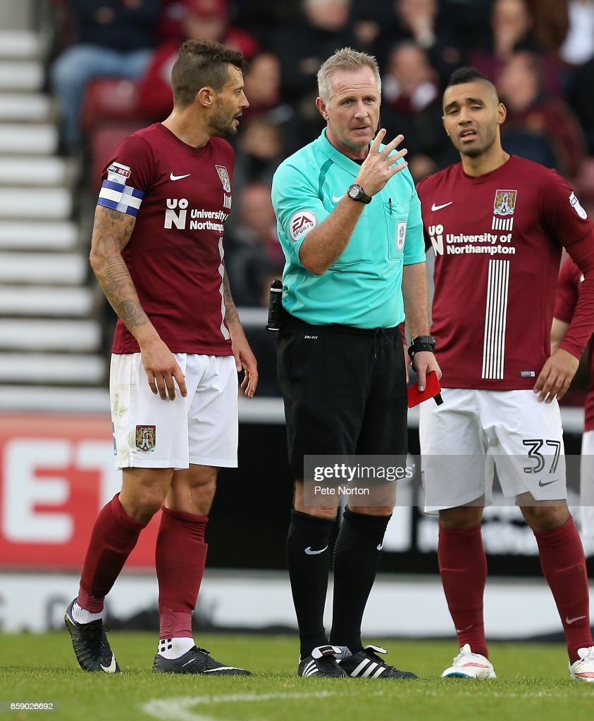 Referre Mark Heywood looks on after showing Alex Revell of Northampton Town a red card during the Sky Bet League One match between Northampton Town and Bristol Rovers at Sixfields on October 7, 2017 in Northampton, England.
