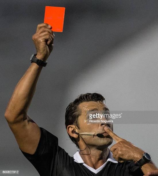 Referre Wagner Reway shows the red card to Rodrigo of Ponte Preta during the match between Ponte Preta and Palmeiras as a part of Campeonato...