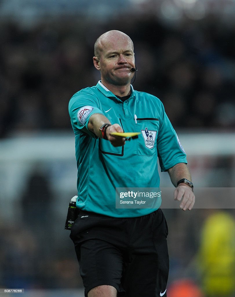 Referree <a gi-track='captionPersonalityLinkClicked' href=/galleries/search?phrase=Lee+Mason&family=editorial&specificpeople=221143 ng-click='$event.stopPropagation()'>Lee Mason</a> pulls out his yellow card during the Barclays Premier League match between Newcastle United and West Bromwich Albion at St.James' Park on February 6, 2016, in Newcastle upon Tyne, England.