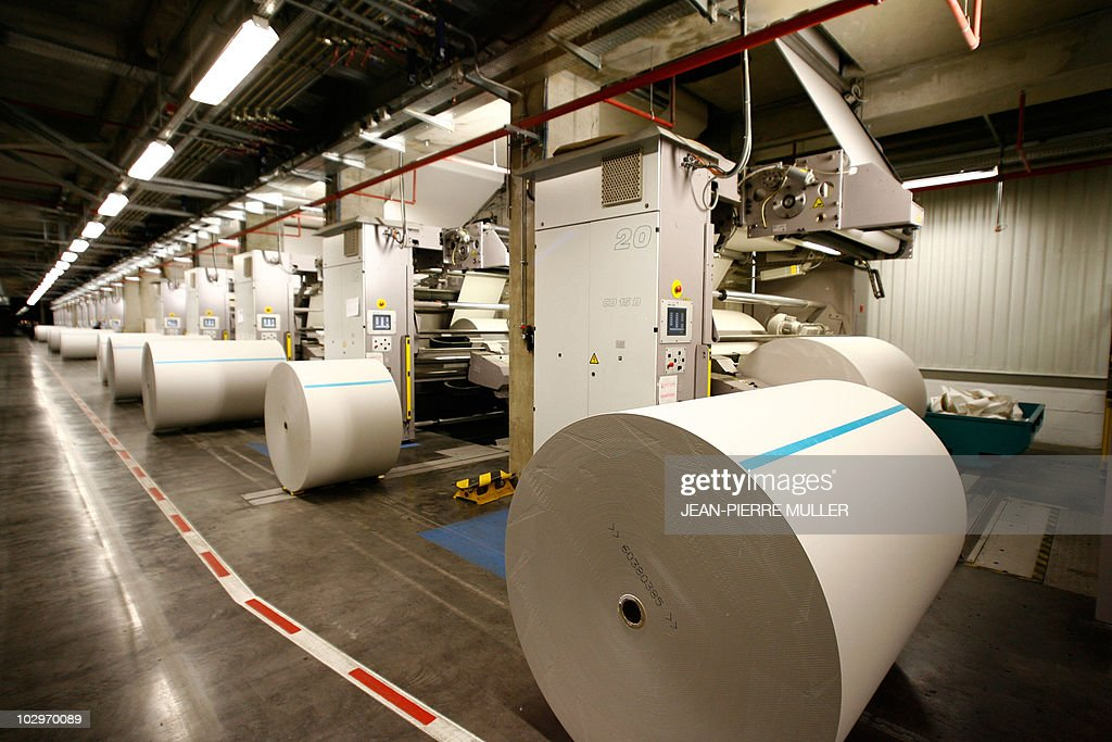 Refill rolls of paper are lined up next to the rotary newspaper printing press machines are stored in the basement of the French newspaper Sud-Ouest on February 19, 2008 in Bordeaux, southern France. AFP PHOTO JEAN-PIERRE MULLER.