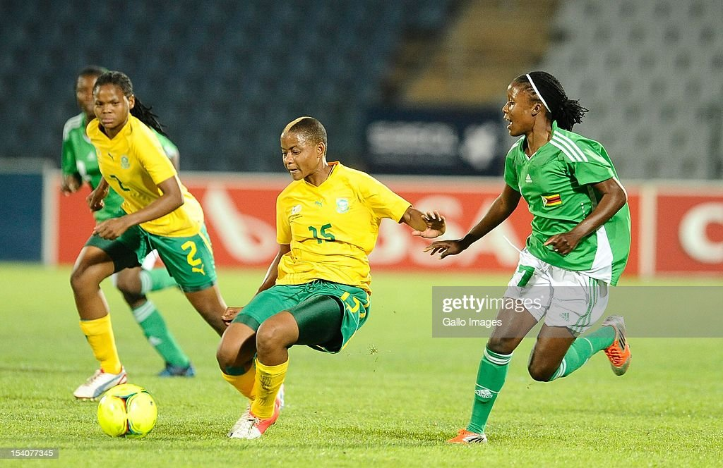 Refiloe Jane of South Africa and Rudo Neshamba (R) of Zimbabwe compete for the ball during the Womens International Friendly match between South Africa and Zimbabwe at Volkswagen Dobsonville Stadium on October 13, 2012 in Dobsonville, South Africa.