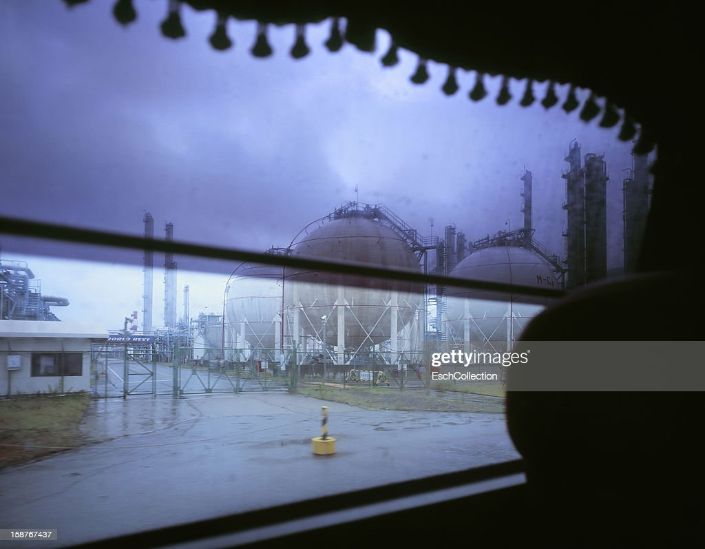 Refinery on a dreary day, from window of a bus : Stock Photo