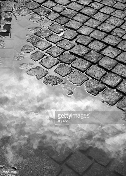 Reflected clouds on a water puddle