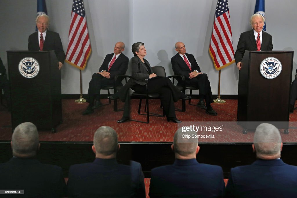 Reflected in a stone column, Homeland Security Secretary <a gi-track='captionPersonalityLinkClicked' href=/galleries/search?phrase=Janet+Napolitano&family=editorial&specificpeople=589781 ng-click='$event.stopPropagation()'>Janet Napolitano</a> and former Secretary <a gi-track='captionPersonalityLinkClicked' href=/galleries/search?phrase=Michael+Chertoff&family=editorial&specificpeople=204729 ng-click='$event.stopPropagation()'>Michael Chertoff</a> listen as Senate Homeland Security and Governmental Affairs Committee Chairman Sen. Joseph Leiberman (I-CT) delivers remarks after receiving the Secretary's Award during a ceremony at the at the U.S. Citizenship and Immigration Services December 19, 2012 in Washington, DC. Lieberman, who is retiring after 24 years in the U.S. Senate, was recognized by Napolitano for his 'advocacy and leadership on behalf of the Department of Homeland Security and the country and for helping to ensure the safety and security of the American people.'