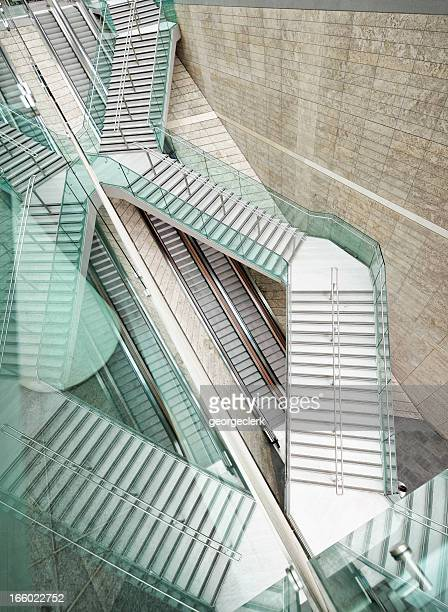 Reflected Modern Architecture - Winding Stairs over Straight Escalators