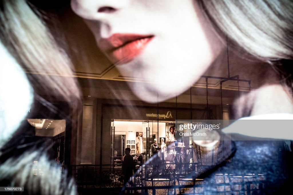 A reflected shopper walks passed a luxury brand store inside the Venetian Casino and hotel on July 29, 2013 in Macau, Macau. Macau, the only place in China with legalized casino gambling is booming. Gambling has been legal in Macau for more than 150 years but has seen a rapid transformation over the last decade from the small time gambling clubs, gangs and prostitution of the 1990s, to becoming the worlds gambling mecca. Last year, Macau generated $38 billion in casino revenue, six times more than Las Vegas, Nevada. Situated just one hour from mainland China and Hong Kong, Macau also known as 'The Oriental Las Vegas ' received 14.1million visitors for the first six months of this year, in the most recent Statistics and Census Bureau report, with close to 90% of visitors being from mainland China, Taiwan and Hong Kong. Although the gambling industry has improved general living standards across Macau, it is not without it's downside. With the influx of big money also comes, higher living costs, with some residents saying issues such as transportation, health care and social welfare have largely been ignored. Property prices have increased dramatically, forcing many small and mid-sized businesses into bankruptcy and pushing some residents to share accommodation or move away completely.