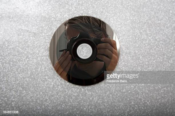 CD reflecting photographer