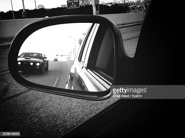Reflection In A Side View Mirror Of A Car