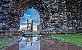 The St Andrews Cathedral in St. Andrews, Scotland is Reflecting in the Water of the last rain.