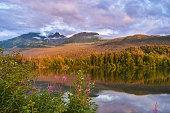 The sun goes down at Reflection Lake in Alaska
